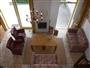 woonkamer met open haard